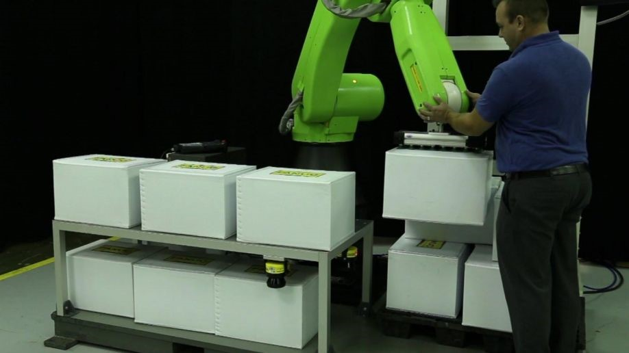 Cobot assisting heavy lift for stacking boxes